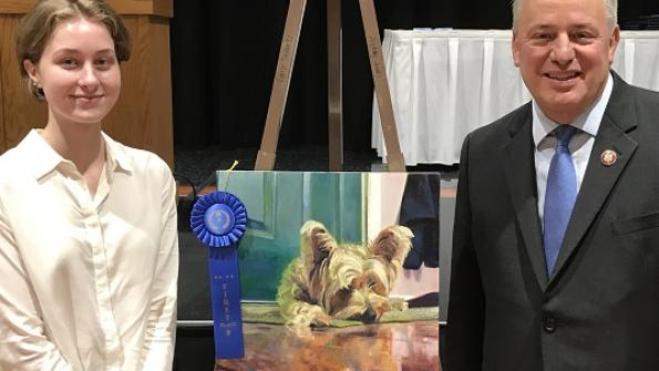 Congressman Doyle with Caden Ferita from Westinghouse Arts Academy, the winner of Pennsylvania's 18th District Congressional Art Competition.