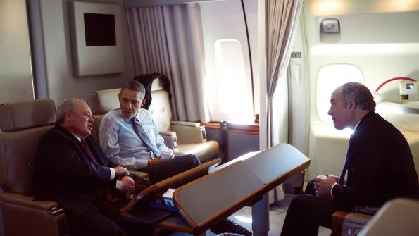 Photo of Congressman Doyle talking to President Obama and Senator Casey aboard Air Force One