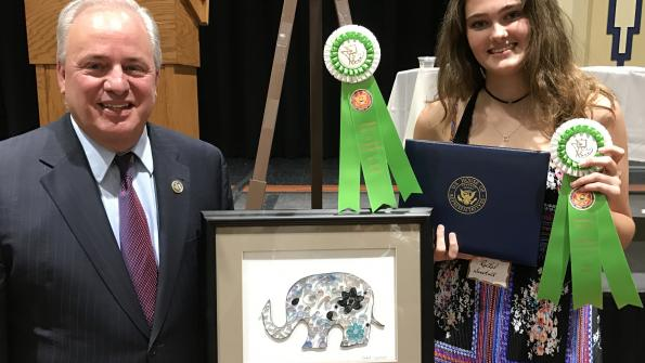 "Congressman Doyle and Rachel Sweetall from Montour High School with her paper, glue, and canvas composition ""Paper Ella,"" which was awarded Fifth Place in his 2017 high school art competition"