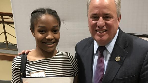 Congressman Doyle with Hailey Pressley fromThe Neighborhood Academy at the 2017 Congressional high school art competition