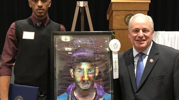 Congressman Doyle with Art Competition 3rd Place recipient Caleb McCoy from Woodland Hills High School and his untitled work in marker and pen.