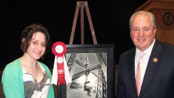 photograph of Congressman Doyle with Miranda Miller from Woodland Hills High School and her charcoal composition City Built on Hope
